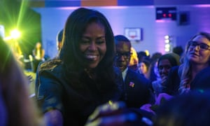 Michelle Obama greets pupils at an event at the Elizabeth Garrett Anderson School in London.