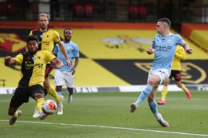 Phil Foden taps home City's third goal from close range.