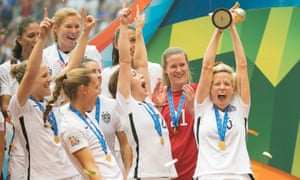 Megan Rapinoe of the US hoists the trophy in Vancouver in 2015
