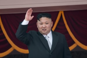 North Korean leader Kim Jong-Un waves from a balcony of the Grand People's Study house