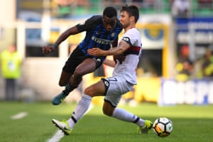 Yann Karamoh attempts to skip past Genoa defender Ervin Zukanovic.