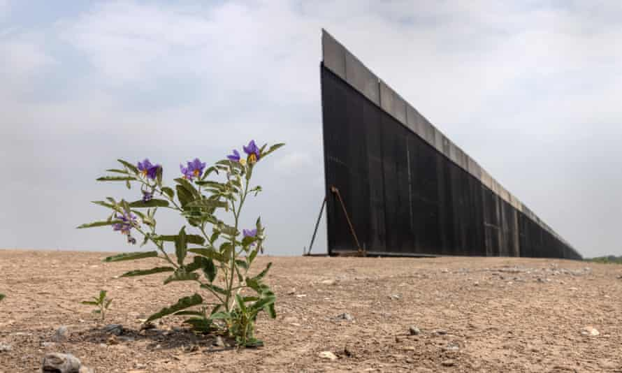 A portion of the US-Mexico border wall stands unfinished near La Joya, Texas, on 14 April.