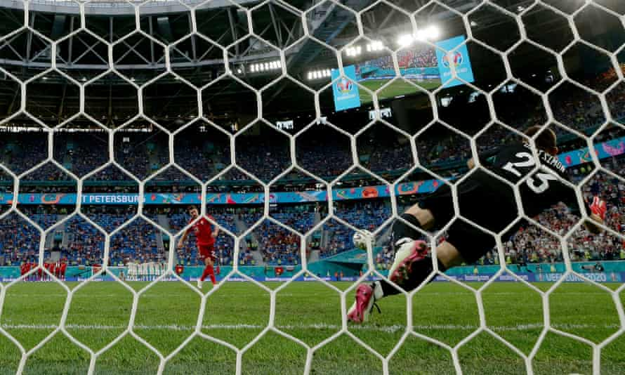 Unai Simón of Spain saves the second penalty from Fabian Schar of Switzerland in the penalty shootout after the 1-1 draw in St Petersburg. Spain won 3-1 on penalties.