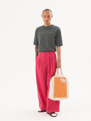 Weiji wears T-shirt, £84, by Cottweiller, and wide-leg chinos, £225, by Raey, both matchesfashion.com. Sliders, £33, by Adidas, from urbanoutfitters.com. Socks, stylist's own. Ecru Tote, £35 weekday.comFashion assistant: Penny Chan. Hair and makeup by Helen Walsh at S Management using Sisley and Christophe Robin. Models: Winston at Ugly, Weiji at Premier, Ritchie and Liam at Select Model Management, Rob Knighton at Next.