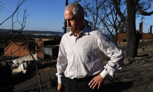 Malcolm Turnbull tours a burned-out area in the NSW town of Tathra on 19 March.