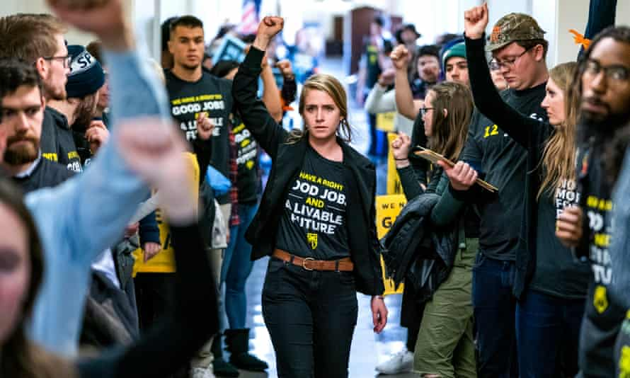 Supporters of Ocasio-Cortez's Green New Deal rally in Washington in December.