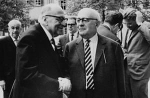 Heidelberg, 1964: Horkheimer, left, shakes hands with Adorno, as Habermas runs his hand through his hair in the background.