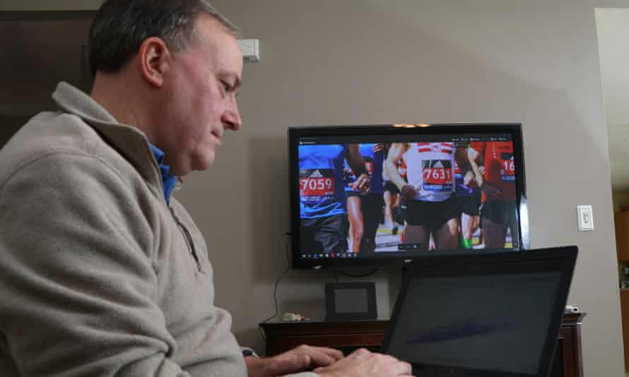 He's got your number: Derek Murphy looks at a graph of runner start and finish times as he works at his Marathon Investigations business at his home in Ohio.