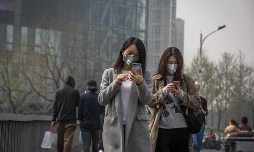 Women walk in Beijing