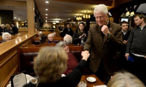 Bill Clinton greets diners at the Puritan Backroom in Manchester, New Hampshire.