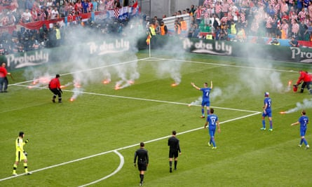 Croatia fans throw flares on to the pitch