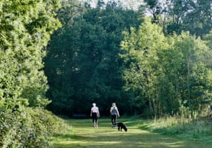 Dog walkers make the most of the cool morning air at Clayfield Copse in Berkshire