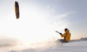 Man kiteboarding in snow