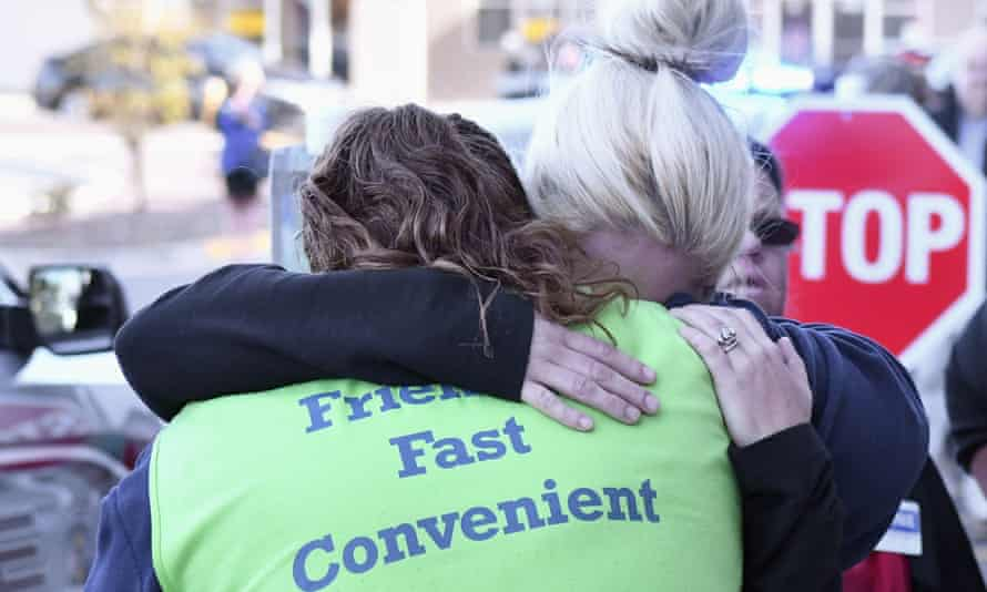 Kroger employees hug each other in the aftermath of the shooting.