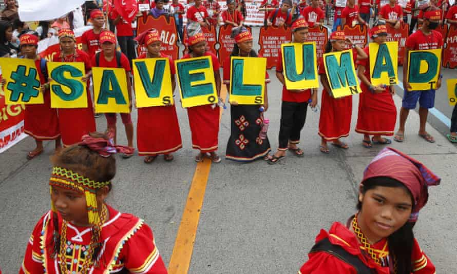 The Philippines' indigenous Lumad people carry the message 'Save Lumad schools' during a march in Manila.