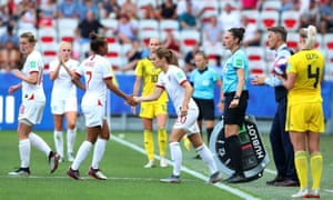 Nikita Parris of England greets Karen Carney as Carney is substituted in her stead.