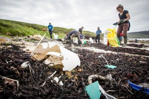 A beach clean on the Isle of Eigg, ScotlandResidents of the Isle of Eigg help to clear plastic debris from the beach at Singing Sands.