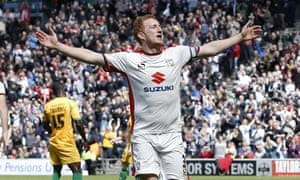 Dean Lewington celebrates his second goal against Yeovil Town as MK Dons sealed automatic promotion