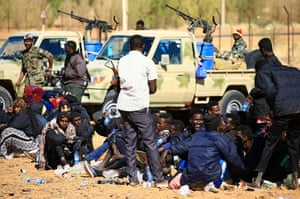 Migrants from Somalia and Ethiopia are detained in Omdourman, on the western outskirts of the capital Khartoum, after Sudanese forces caught them travelling illegally on the Libyan-Sudan border on January 8, 2017.