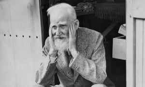 George Bernard Shaw sits in the doorway of the garden shed at his home in Ayot St Lawrence, Hertfordshire, 1946.