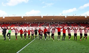 Southampton's players and staff celebrate their Premier League status after their 3-3 draw with Bournemouth at St Mary's Stadium after Matt Targett scored the 1,000th Premier League goal of 2018-19.