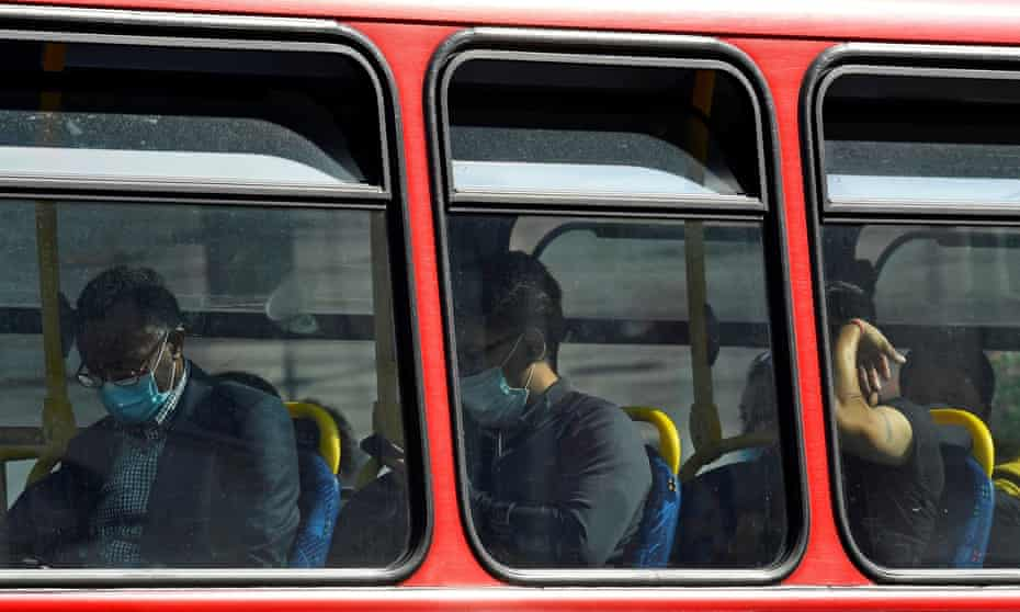 Passengers wear protective face coverings on a London bus.