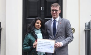 Konnie Huq and Steven Lotinga of the Publishers Association with a letter signed by 90 MPs at Downing Street on Thursday 31 October