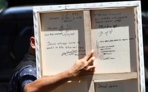 """The writing at the back reads, """"satu hati, satu rasa di dalam cinta"""" (one heart, one feeling in love), and is signed by the death-row inmates."""