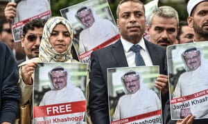 Protestors hold pictures of missing journalist Jamal Khashoggi during a demonstration in front of the Saudi Arabian consulate in Istanbul