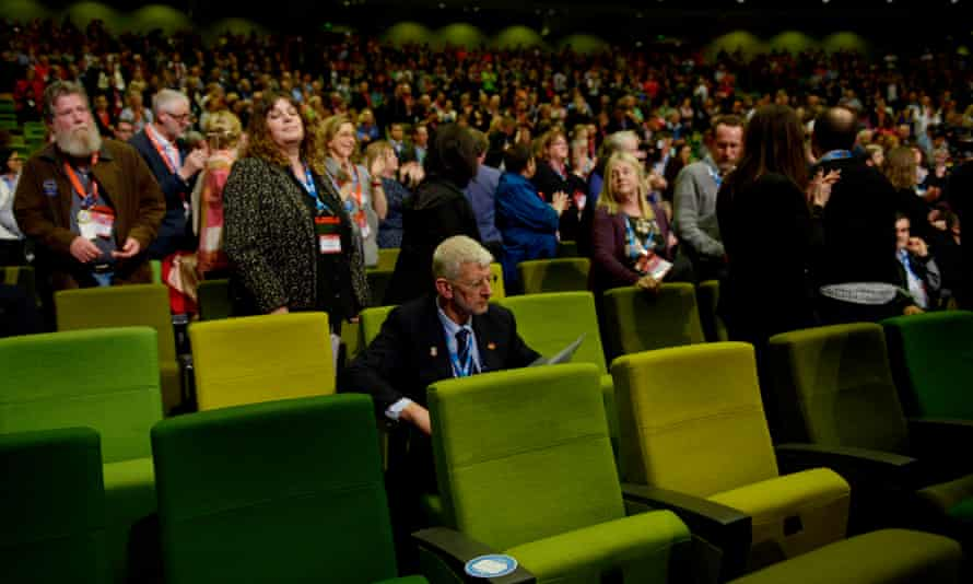 Odd one out: the former head of the SDA, Joe de Bruyn remains seated as delegates at the 2015 ALP National conference stand to show their support for marriage equality.