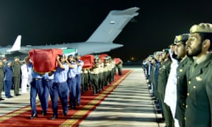 Emirati soldiers carry coffins of UAE soldiers killed in the deadly missile attack.