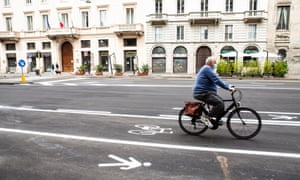 A cyclist in a new bike lane in Milan