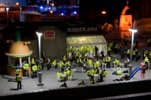 Miniature police outside a Burger King in The Aftermath Dislocation Principle by Jimmy Cauty
