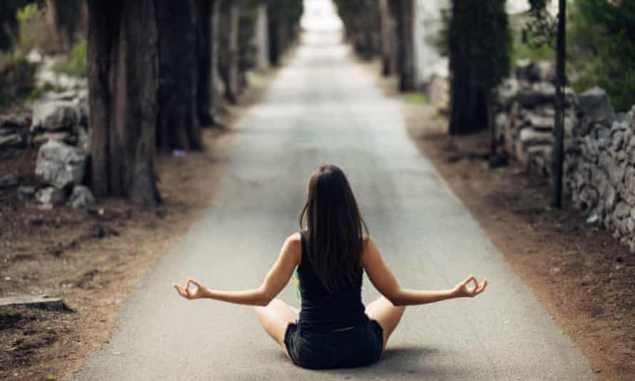 Carefree calm woman meditating in nature.