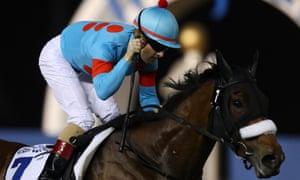 Christophe Lemaire riding Almond Eye wins the Dubai Turf
