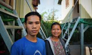 Former scavenger Suon Vu (left) and his wife Say Pheap, at their new World Housing home.