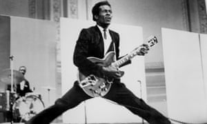 Rock'n'roll musician Chuck Berry does the splits as he plays his Gibson hollowbody electric guitar in circa 1968.
