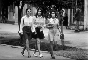 Young women wearing mini-skirts walking down the street in the city of Kabul, 1972.