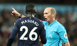 Arthur Masuaku is ushered off the pitch by referee Mike Dean after receiving a second yellow card.