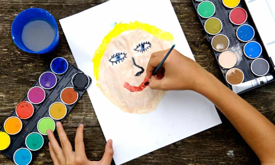 A child painting a smiling face