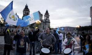 Guatemalans react on Thursday after the midnight resignation of President Otto Pérez Molina in Guatemala City.