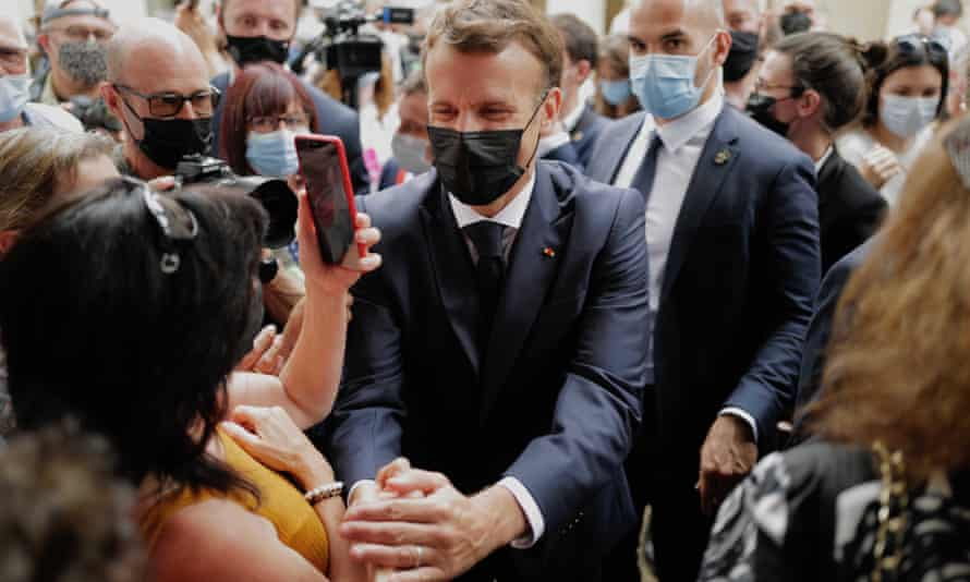 Emmanuel Macron meets local people during a visit to Martel, southern France