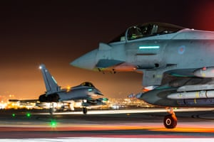 Photographer of the Year first place. A pair of RAF Typhoons wait to taxi out and depart from RAF Akrotiri on a night mission over the Middle East.
