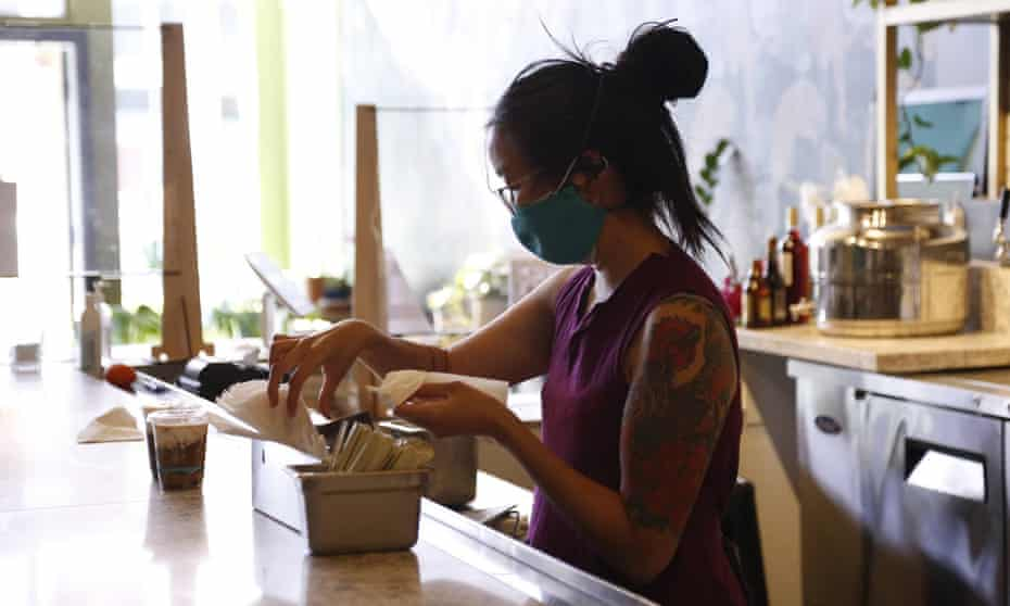 Diana Wu, Oakland Bloom board member, sets up for chef Pa Wah's pop up at Understory, a new restaurant in Oakland, California.