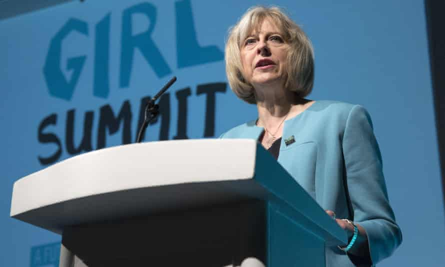 Theresa May – then the home secretary – speaks at the Girl Summit in London in 2014, where she announced that parents will face prosecution if they fail to prevent their daughters suffering female genital mutilation.