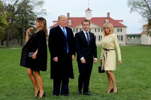 Melania and Donald Trump pose with Emmanuel and Brigitte Macron as the presidential couples prepare to have their picture taken in Virginia, US