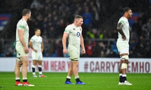 England's Sam Underhill (centre) and Courtney Lawes (right) look pensive as they wait for the TMO decision.