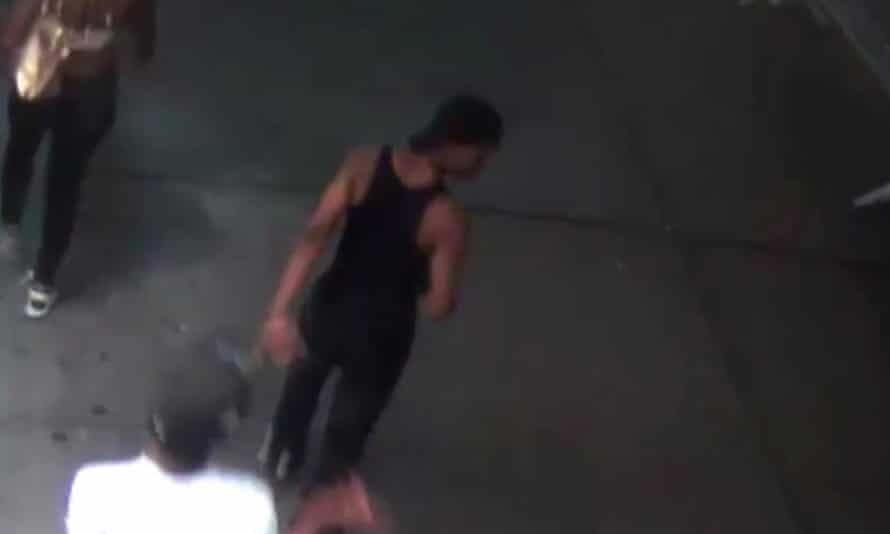 Police have released surveillance footage of the suspect wearing a black tank top and hat, strolling down the street shortly after the attack.