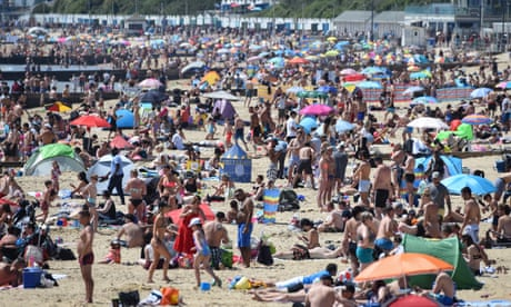 UK crowds enjoy the May sunshine as lockdown eases – in pictures
