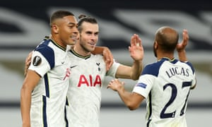 Tottenham's Gareth Bale celebrates with Carlos Vinícius and Lucas Moura after the Welshman's cross led to an own goal by Andrés Andrade of Lask